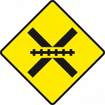 Level crossing ahead, unguarded by gates or lifting barrier